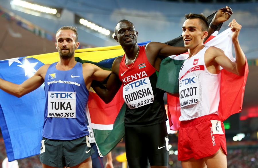 BEIJING, CHINA - AUGUST 25: (L-R) Bronze medalist Amel Tuka of Bosnia and Herzegovina, gold medalist David Lekuta Rudisha of Kenya and silver medalist Adam Kszczot of Poland celebrate after the Men's 800 metres final during day four of the 15th IAAF World Athletics Championships Beijing 2015 at Beijing National Stadium on August 25, 2015 in Beijing, China. (Photo by Michael Steele/Getty Images)