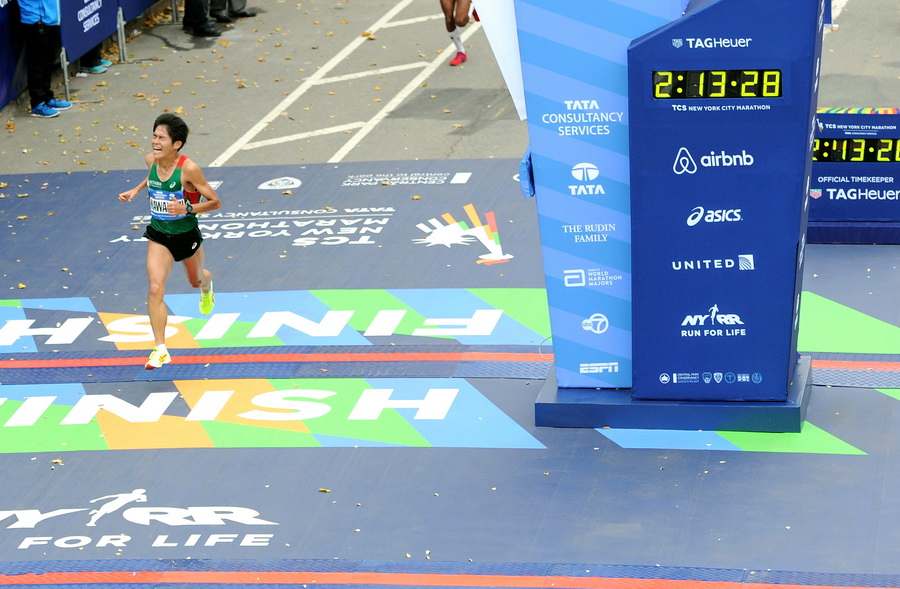 NEW YORK, NY - NOVEMBER 01:  Yuki Kawauchi of Japan crosses the finish line at TAG Heuer Official Timekeeper and Timepiece of 2015 TCS New York City Marathon on November 1, 2015 in New York City.  (Photo by Craig Barritt/Getty Images for TAG Heuer)