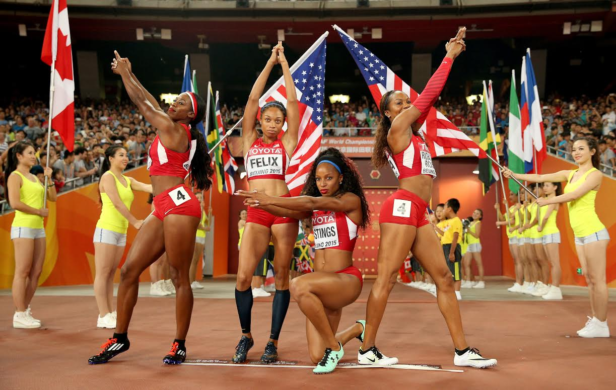 BEIJING, CHINA - AUGUST 30: Francena McCorory of the United States, Sanya Richards-Ross of the United States, Natasha Hastings of the United States and Allyson Felix of the United States pose prior to the Women's 4x400 Relay Final during day nine of the 15th IAAF World Athletics Championships Beijing 2015 at Beijing National Stadium on August 30, 2015 in Beijing, China. (Photo by Patrick Smith/Getty Images)