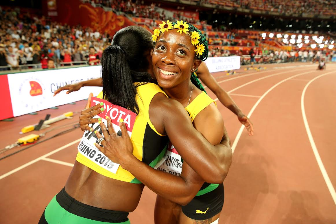 BEIJING, CHINA - AUGUST 29: Shelly-Ann Fraser-Pryce of Jamaica celebrates after crossing the finish line to win gold in the Women's 4x100 Metres Relay final during day eight of the 15th IAAF World Athletics Championships Beijing 2015 at Beijing National Stadium on August 29, 2015 in Beijing, China. (Photo by Andy Lyons/Getty Images)