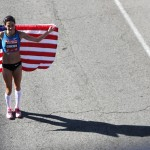 HOUSTON, TX - JANUARY 14: Kara Goucherm, who finished with a time of 2:26:06, holds an American flag after the U.S. Marathon Olympic Trials January 14, 2012 in Houston, Texas. (Photo by Thomas B. Shea/Getty Images)