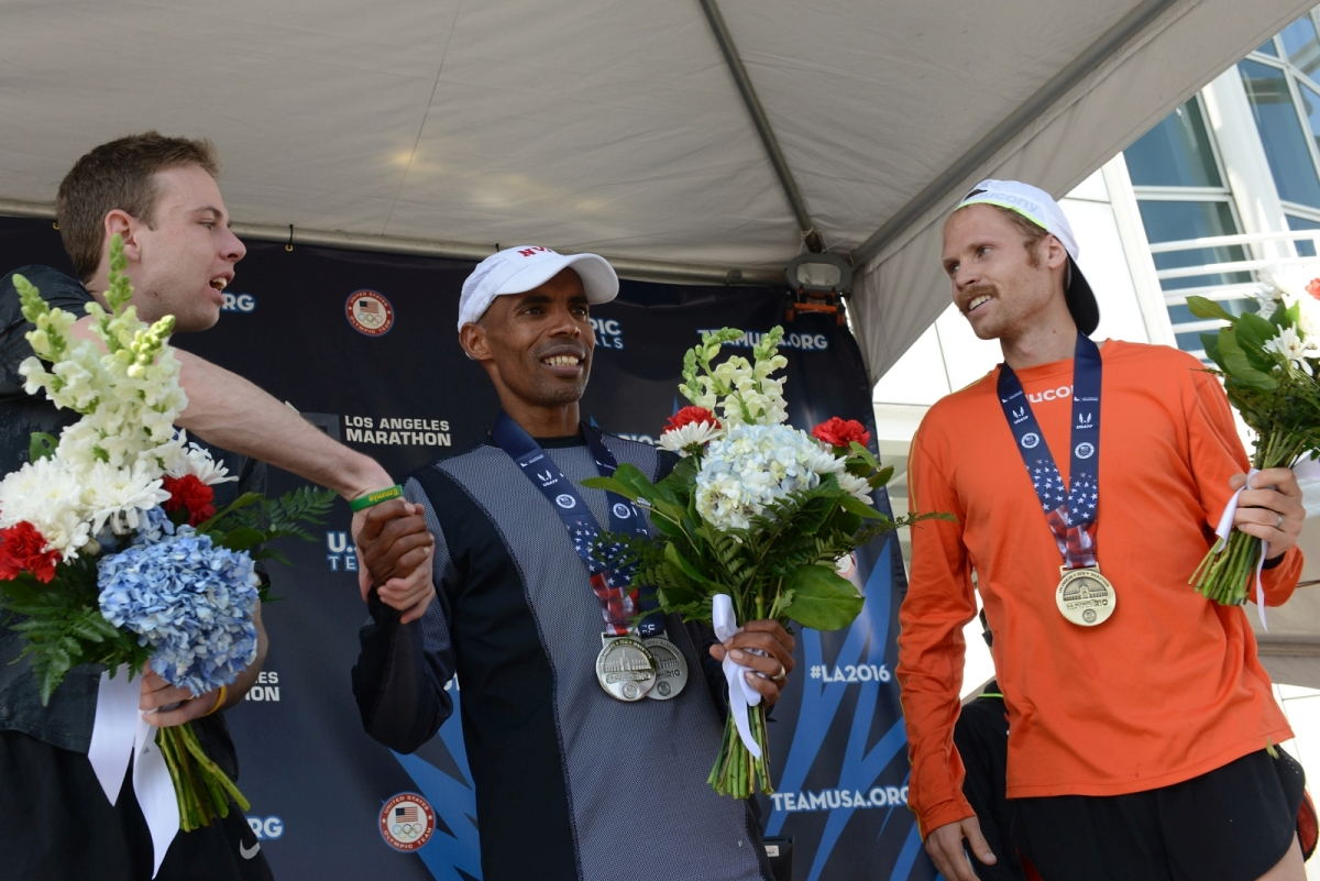 LOS ANGELES, CA - FEBRUARY 13: (L-R) Galen Rupp, Meb Keflezighi and Jared Ward celebrate after qualifying for the Olympic Team at the U.S. Olympic Team Trials - Marathon on February 13, 2016 in Los Angeles, California. (Photo by Joshua Blanchard/Getty Images)