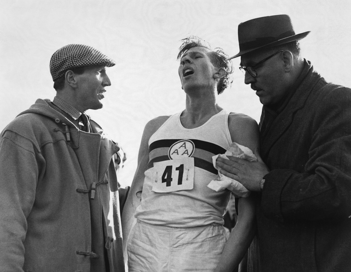 Roger Bannister just after his world record beating run at Oxford when he ran a mile in less than four minutes. His time tonight was 3 min 59.4 sec. | Location: Iffley Road, Oxford, England, UK. (Photo by © Hulton-Deutsch Collection/CORBIS/Corbis via Getty Images)