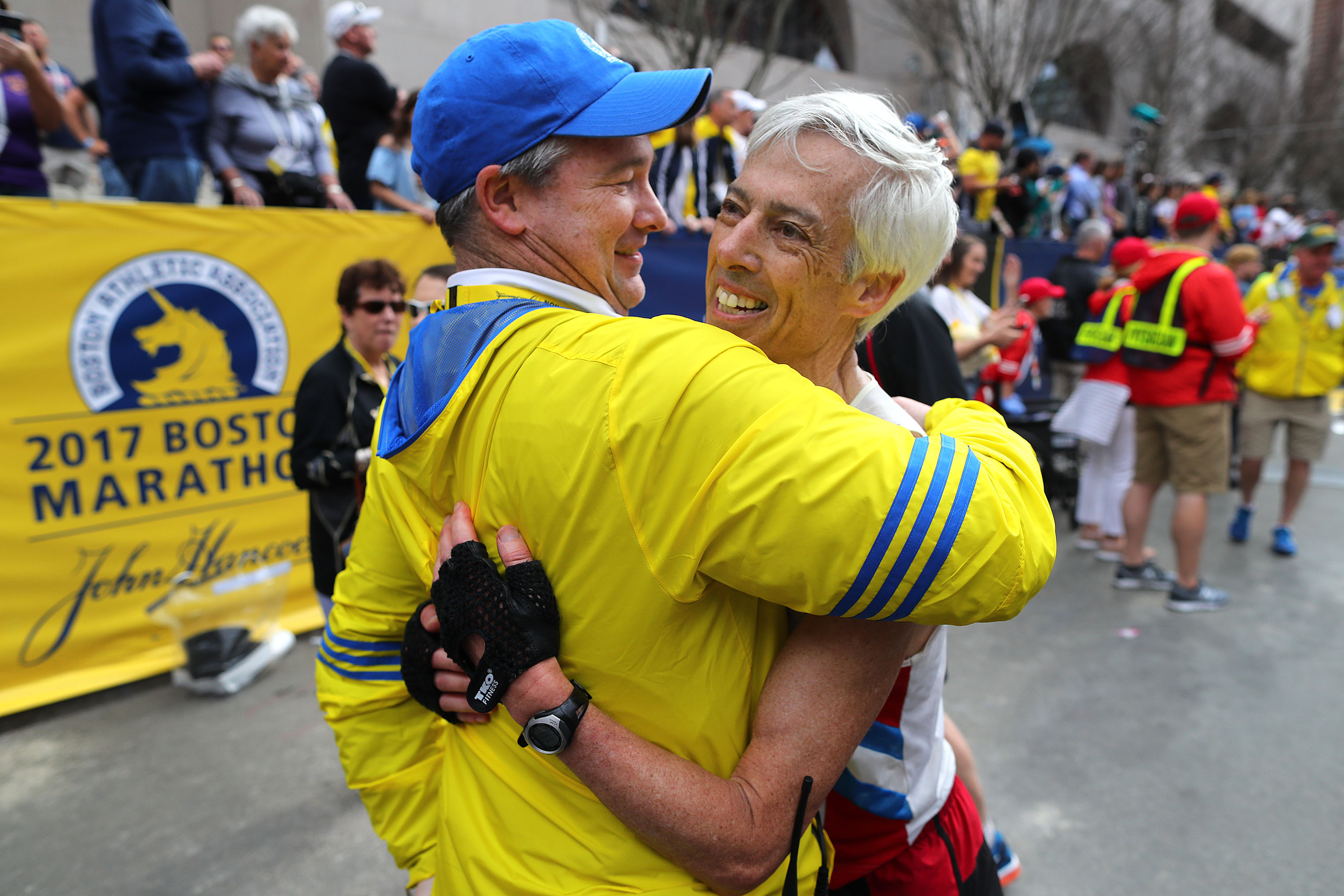 BOSTON, MA - APRIL 17: Bennett (Ben) Beach, right, is hugged by Boston Athletic Association's Jack Fleming after Beach finished in his 50th straight Boston Marathon at the 121st Boston Marathon finish line on April 17, 2017. (Photo by John Tlumacki/The Boston Globe via Getty Images)