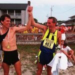 FALMOUTH - AUGUST 16: Master runners Steve Plasencia, left, and Keith Anderson, right, came in together to finish the Falmouth Road Race. (Photo by Evan Richman/The Boston Globe via Getty Images)