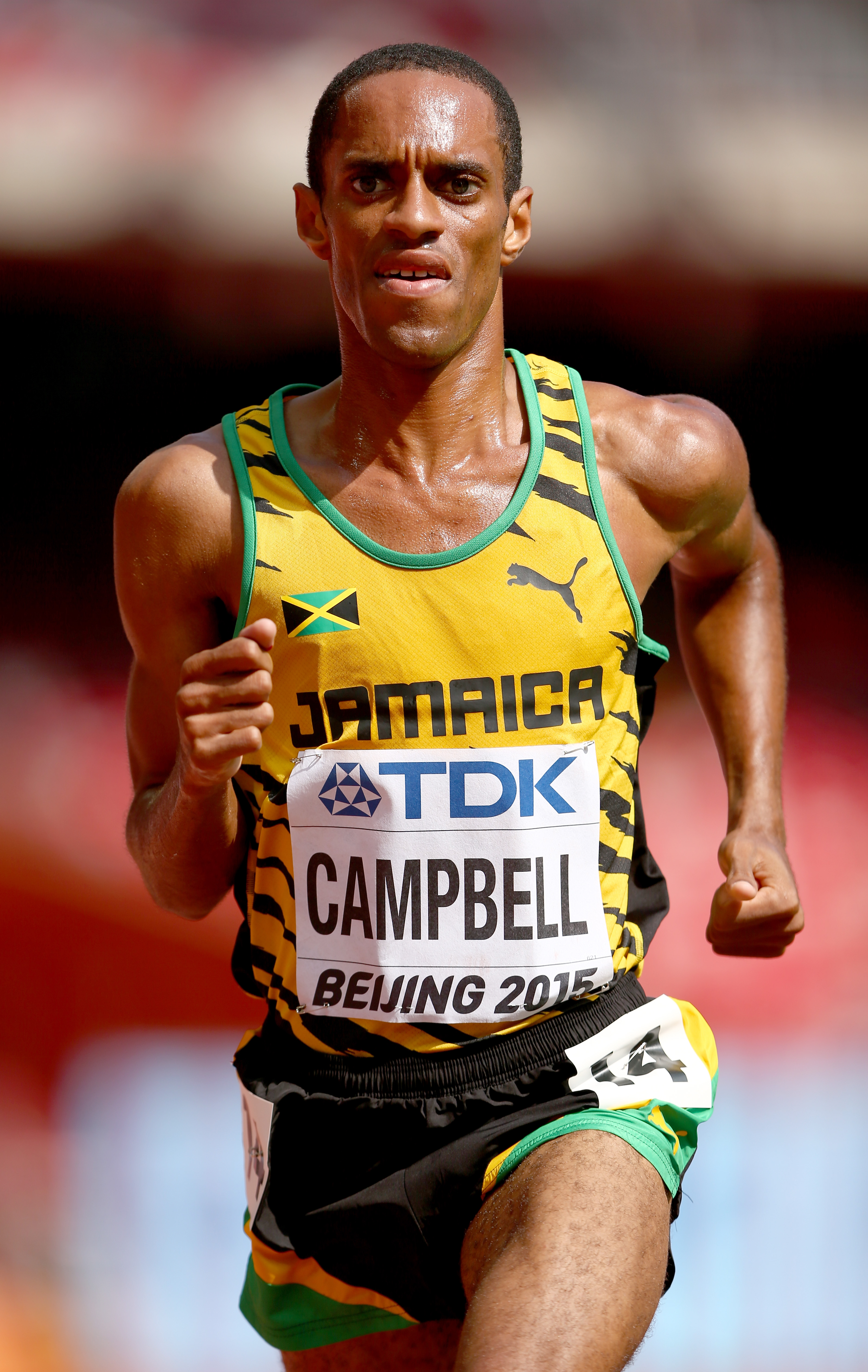 BEIJING, CHINA - AUGUST 26: Kemoy Campbell of Jamaica competes in the Men's 5000 metres heats during day five of the 15th IAAF World Athletics Championships Beijing 2015 at Beijing National Stadium on August 26, 2015 in Beijing, China. (Photo by Cameron Spencer/Getty Images)