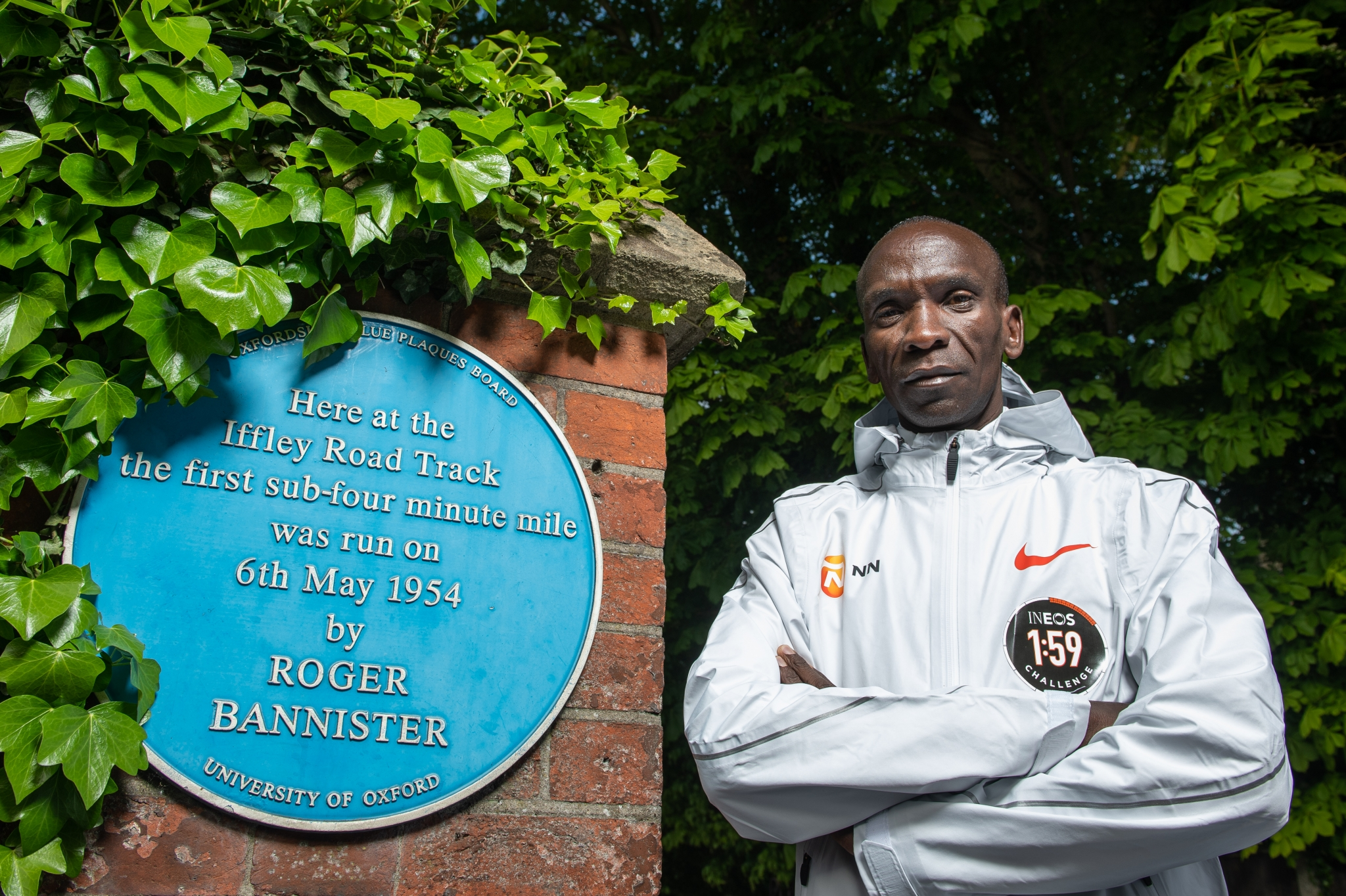 Eliud Kipchoge KEN, with the Roger Bannister blue plaque at the Iffley road running track on the 30th April 2019. Photo: Thomas Lovelock for london marathon events
