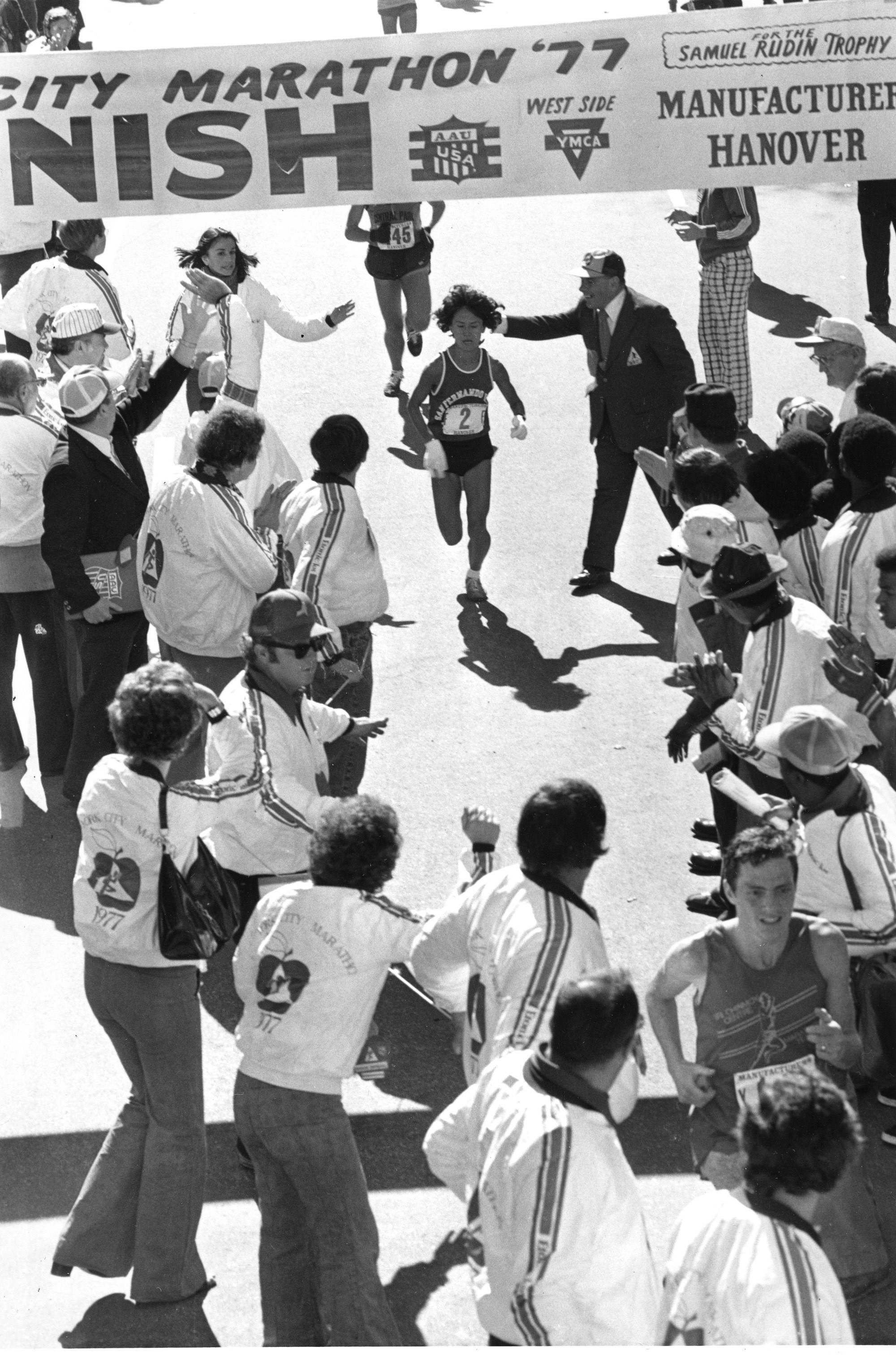 Miki Gorman (2) approaches the finish line in Central Park as the first woman finisher in the New York City Marathon, Sunday, Oct. 23 1977. The 42-year-old Japanese-American from San Francisco, Ca., won the 26-mile, 335-yard race for the second straight year. (AP Photo)