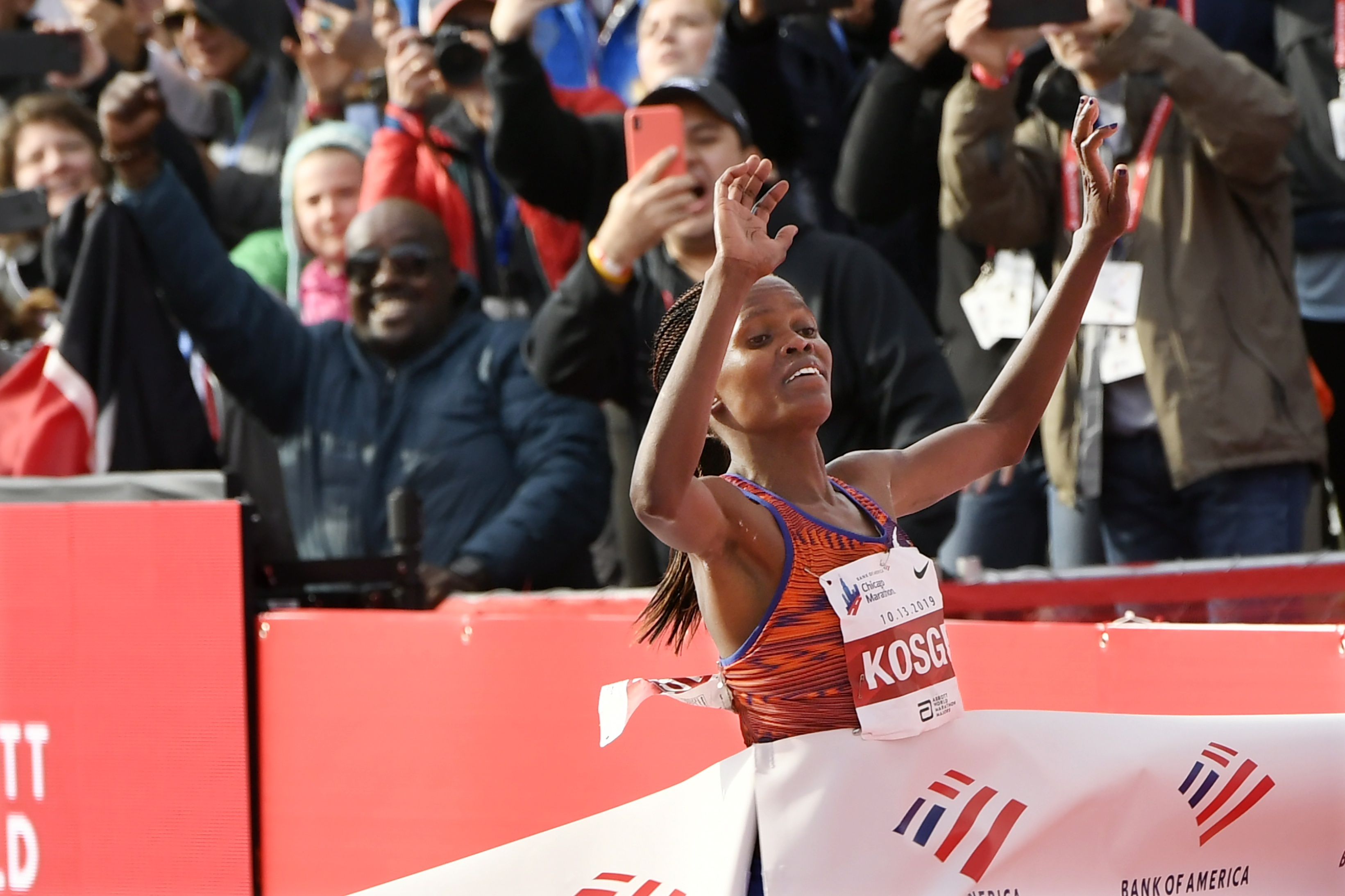 Brigid Kosgei of Kenya, wins the Women's Bank of America Chicago Marathon while setting a world record of 2:14:04 on Sunday, Oct. 13, 2019, in Chicago. (AP Photo/Paul Beaty)