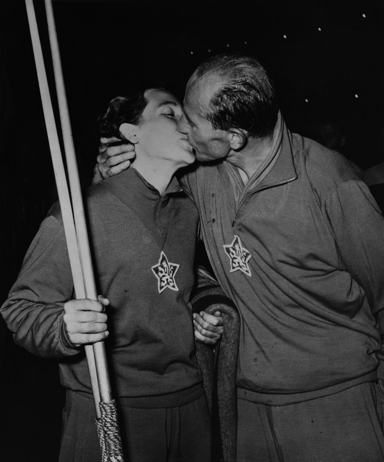 The Czechoslovakian athlete Emil Zatopek kisses his wife Dana, after they secure two gold medals in the 10,000 meters and the javelin at the European Games. Switzerland, 1954. (Photo by © Hulton-Deutsch Collection/CORBIS/Corbis via Getty Images)